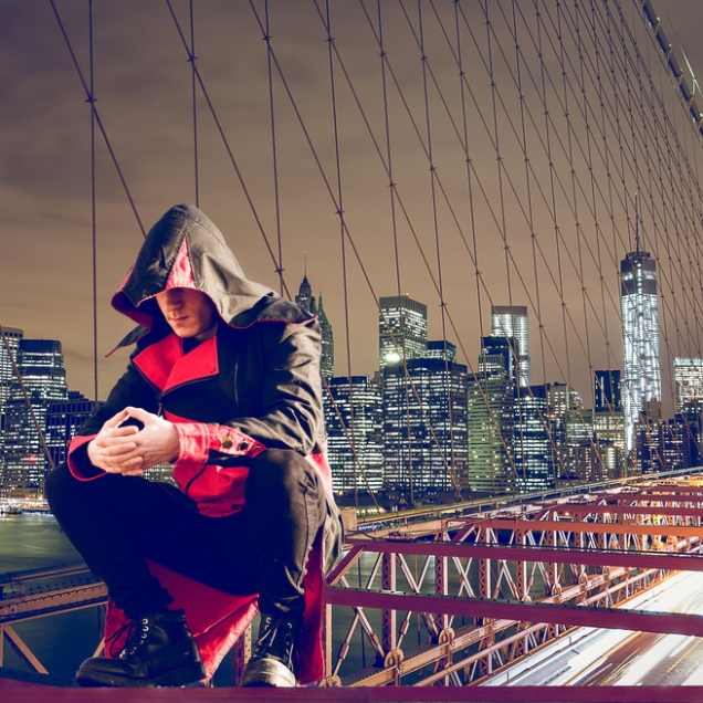 paranormal man in hood on top of bridge